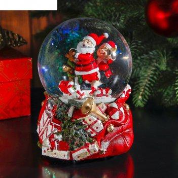 Сувенир снежный шар дед мороз на конфетных санях музык., механич.