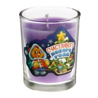 Свеча в стеклянном стаканчике счастливого нового года