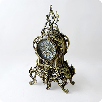 каминные часы из камня